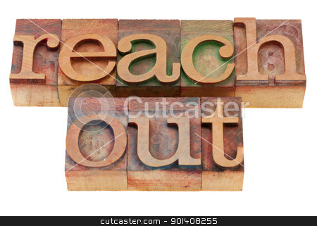 reach out phrase in letterpress type stock photo, reach out phrase in vintage wood letterpress printing blocks, isolated on white by Marek Uliasz