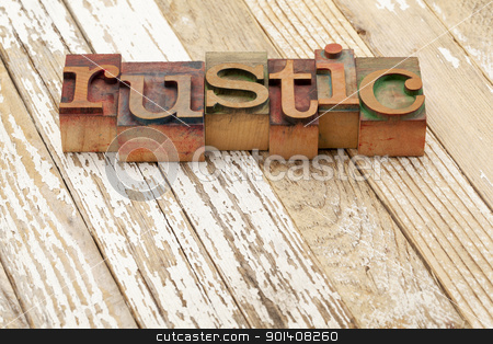 rustic word in letterpress type stock photo, rustic word in vintage letterpress printing blocks against old grunge wood surface painted white by Marek Uliasz