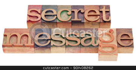 secret message in letterpress type stock photo, secret message phrase in vintage wood letterpress printing blocks isolated on white by Marek Uliasz