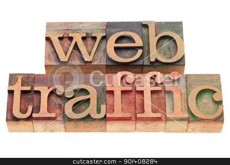 web traffic in letterpress type stock photo, web traffic - isolated words in vintage wood letterpress printing blocks by Marek Uliasz