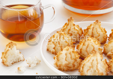 tea and coconut macaroons stock photo, plate of coconut macaroon cookies and cup of tea by Marek Uliasz