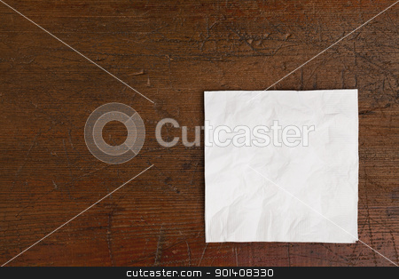white napkin and old table stock photo, white cocktail napkin on old scratched wood table by Marek Uliasz