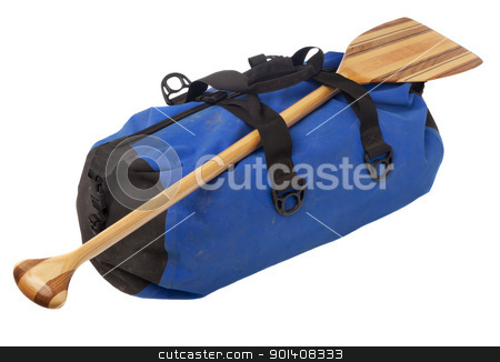 canoe paddle and waterproof duffel stock photo, paddling trip or vacation concept - wooden canoe paddle and waterpoof duffel with river mud stains, isolated on white by Marek Uliasz