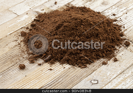 Canadian sphagnum peat moss stock photo, Canadian sphagnum peat moss used as soil conditioner in gardening, a small pile on a grunge wooden surface by Marek Uliasz