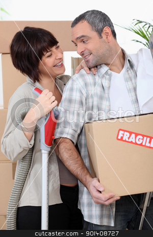 Couple moving into new home with boxes marked fragile stock photo, Couple moving into new home with boxes marked fragile by photography33