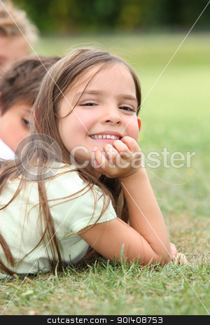 Girl lying in the grass stock photo, Girl lying in the grass by photography33