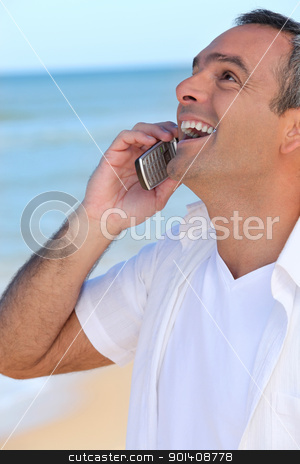 Mature man laughing into his cellphone stock photo, Mature man laughing into his cellphone by photography33