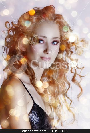 beautiful woman with lights. stock photo, beautiful young woman with hair blowing in wind and sparkling bokeh lights background by lubavnel
