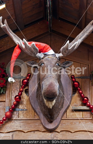 Christmas Moose stock photo, Elk in Santa cap at Christmas market by Valentyna Chukhlyebova 