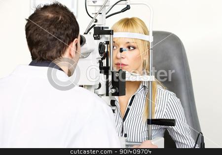 attendance at the optometrist stock photo, female patient is having a medical attendance at the optometrist by iMarin