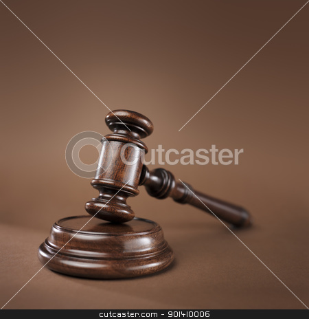 The Law stock photo, High quality wooden gavel and block on brown background. Short depth-of-field. by Stocksnapper
