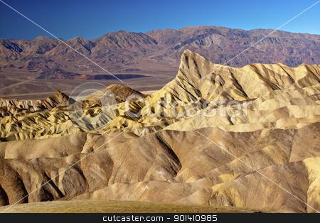 Zabruski Point Manly Beacon Death Valley National Park Californi stock photo, Zabriski Point Manly Beacon Mudstones form Badlands  Death Valley National Park California by William Perry