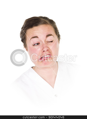 Making a funny face stock photo, Young woman making a funny face isolated on white background by Anne-Louise Quarfoth