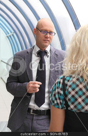 Business man and the woman stock photo, Business man and the woman discuss the project by Artamonov Yury