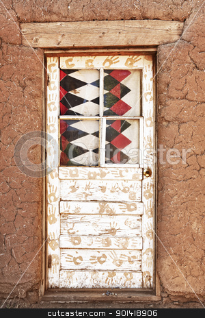 Decorated Door and Adobe Building stock photo, Decorated Door and Adobe Building, Taos Pueblo by Bryan Mullennix