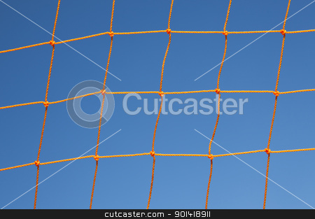 Soccer Goal Net Against Blue Sky stock photo, Orange soccer goal net against blue sky by Bryan Mullennix