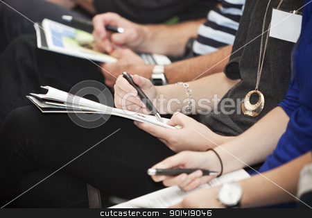 People writing stock photo, Row of people with papers adn pencils by Anne-Louise Quarfoth