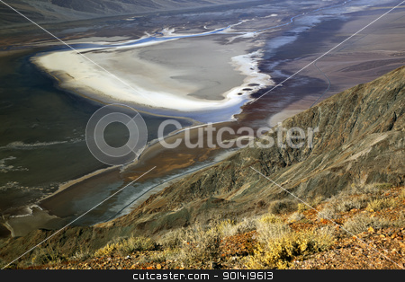 Badwater from Dante's View with Black Mountains Death Valley Nat stock photo, Salt Badwater Basin from Dante's View Death Valley National Park California Lowest spot in the Western Hemisphere 282 Feet below Sea Level from Highest Point in Death Valleyl by William Perry