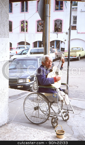 Mexican musician. stock photo, Homeless mexican guitarist musician performing on the streets of Mexico handicapped, and in a wheelchair. by OSCAR Williams