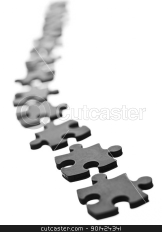 Jigsaw pieces stock photo, Black Jigsaw pieces in a row isolated on white by Anne-Louise Quarfoth