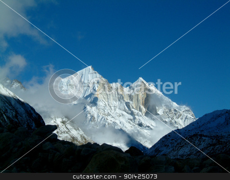 mount bhagarathi stock photo, pristine view over mount bhagarathi, over 7700m high, few clouds floating about by Paul Prescott