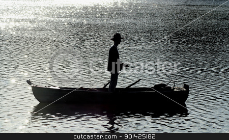 silhouette of man fishing stock photo, silhouette of man fishing by Paul Prescott