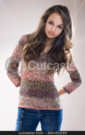 Beautiful fashionable brunette model. stock photo, Half length portrait of beautiful fashionable brunette model in jeans and floral pattern sweater. by exvivo