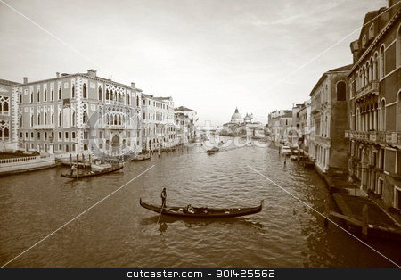 Venice, Italy, stock photo, VENICE - OCTOBER 28: (Shot as Sepia) Couple on gondola ride on October 28, 2009 in Venice. Thousands of gondolas navigated in the 18th century, with only several hundred left today for tourism. by Paul Prescott