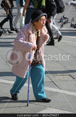 Woman, Venice, Italy stock photo, VENICE - OCTOBER 26:Old Japanese tourist on St Mark's square on October 26, 2009 in Venice, Italy. Japanese and Chinese make up the largest segment for foreign tourism. by Paul Prescott