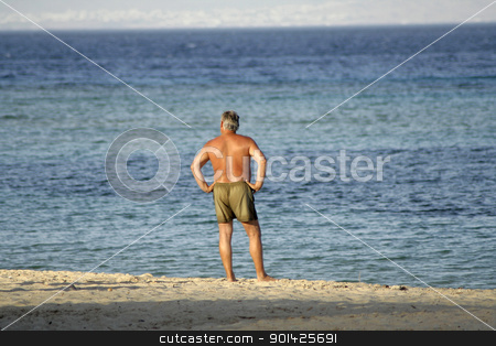 man on beach, red sea, sinai, egypt stock photo, man on beach, red sea, sinai, egypt by Paul Prescott