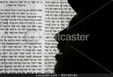 hebrew writing stock photo, Meron, Israel - 6 May 2007. Lag Ba'omer pilgrim silhouette in front of hebrew poster writing during Jewish pilgrimage festival by Paul Prescott