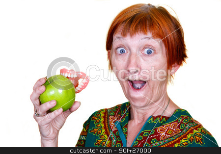 losing yourself stock photo, Elderly lady losing her teeth on a bite of an apple by Paul Prescott