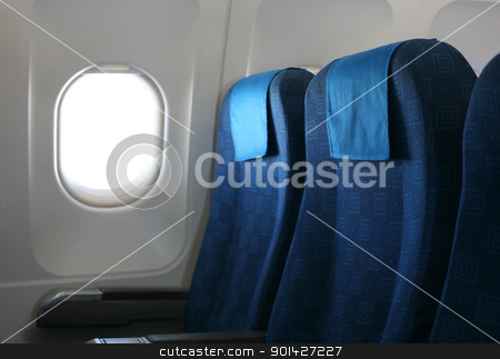 airplane seat and window stock photo, Airplane seat and window inside an aircraft by Paul Prescott