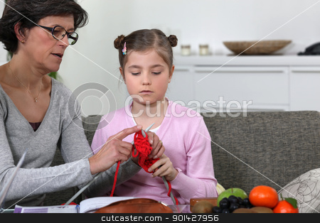 Grandmother teaching her granddaughter how to knit stock photo, Grandmother teaching her granddaughter how to knit by photography33