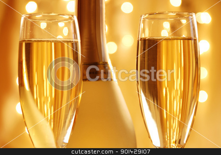 Two glasses of champagne stock photo, Two glasses of champagneagainst golden background by sutike