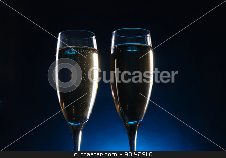 champagne glasses stock photo, champagne glasses on dark background by sutike