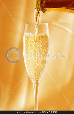 Glass of champagne  stock photo, Glass of champagne against golden background by sutike