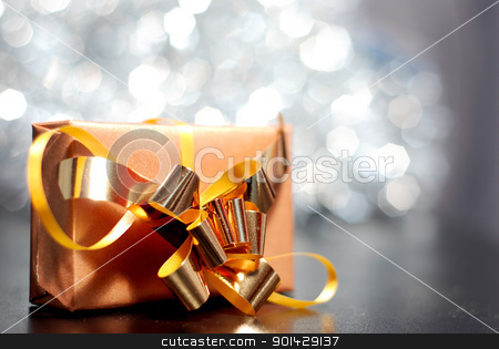 gift box stock photo, A single gift box with shimmering lights in background by sutike