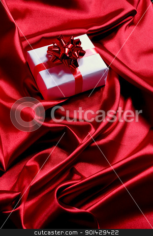 gift box stock photo, white gift box on red satin background  by sutike