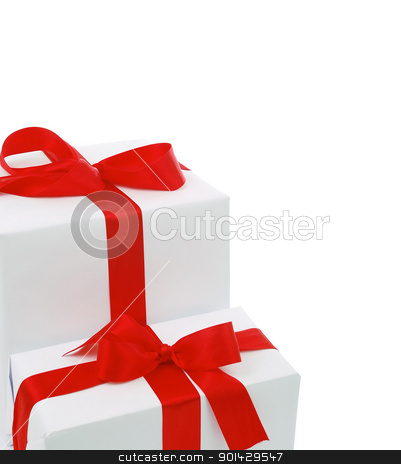 Christmas gift boxes with red bow stock photo, Christmas gift boxes with red bow on isolated white background by sutike