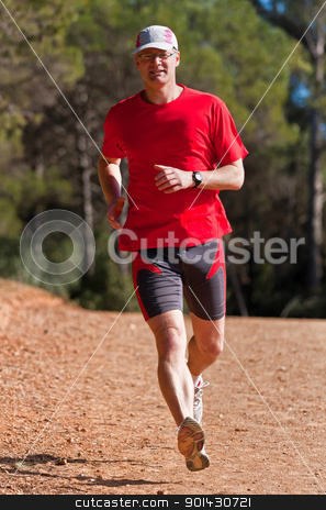 Young runner stock photo, Young runner while training for a competition by ARPAD RADOCZY
