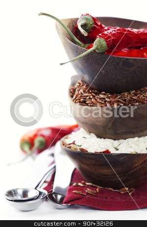 variety of rice stock photo, Bowls of uncooked rice over white with copyspace by klenova
