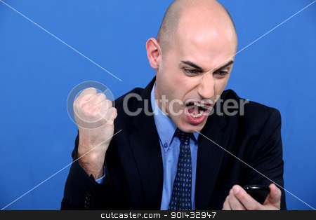Angry bald businessman holding telephone stock photo, Angry bald businessman holding telephone by photography33