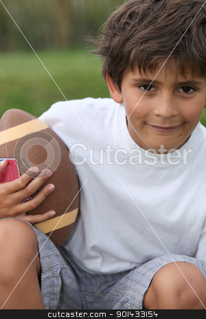 boy playing American football stock photo, boy playing American football by photography33