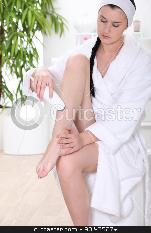 Woman shaving legs stock photo, Woman shaving legs by photography33
