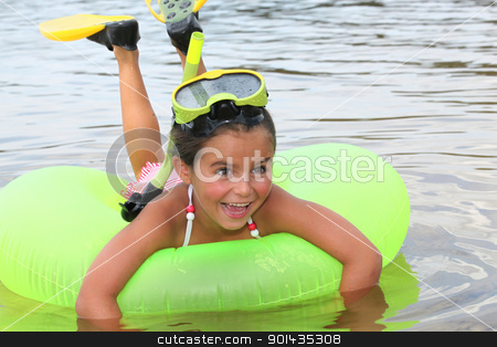 Young girl learning to snorkel stock photo, Young girl learning to snorkel by photography33