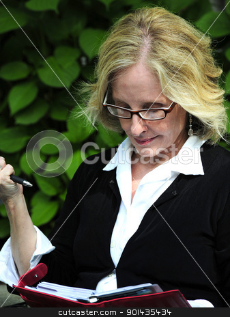 Businesswoman. stock photo, Businesswoman making an appointment. by OSCAR Williams