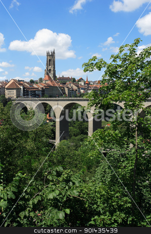 Fribourg Switzerland stock photo, Photo of the bridge and church tower in Fribourg, Switzerland. by © Ron Sumners