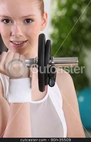 Young woman using a barbell stock photo, Young woman using a barbell by photography33