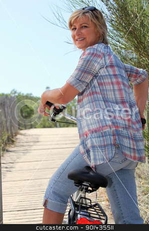 senior woman riding a bike stock photo, senior woman riding a bike by photography33